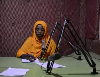 A presenter at Radio Shabelle reads the news. With a population that is still one of the world's poorest, radio continues to be one of the primary sources of information for many in Somalia. AU-UN IST PHOTO / TOBIN JONES.